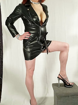TGirl Lucy being Dom in leather look dress and big tits