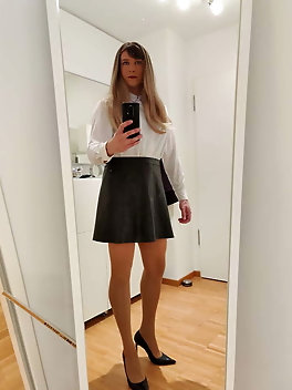 Sissy wearing white blouse black leather skirt high heels